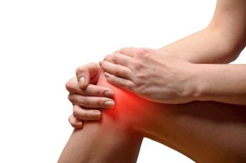 Young woman having knee pain